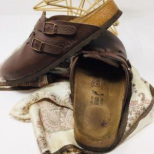 Birkenstock's Brown size 10.